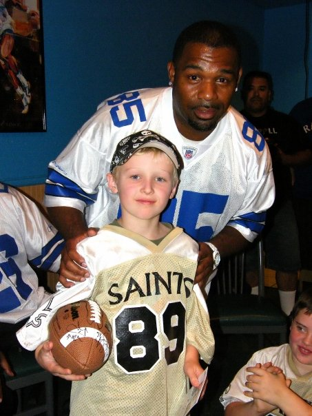 Kevin Williams Poses with 4th Grade Ticket Champion